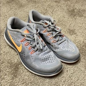 Gray and orange Nike fit sole sneakers